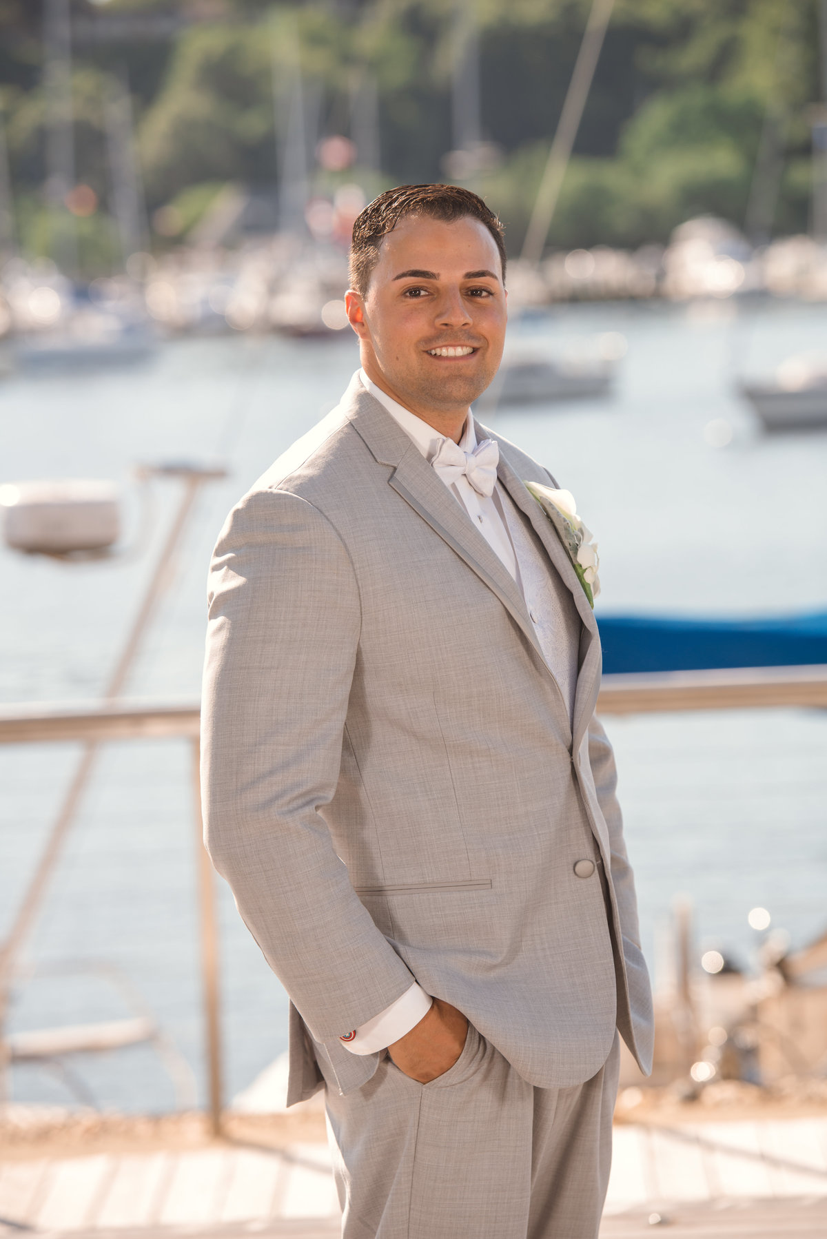 Groom at the docs of Harbor Club at Prime