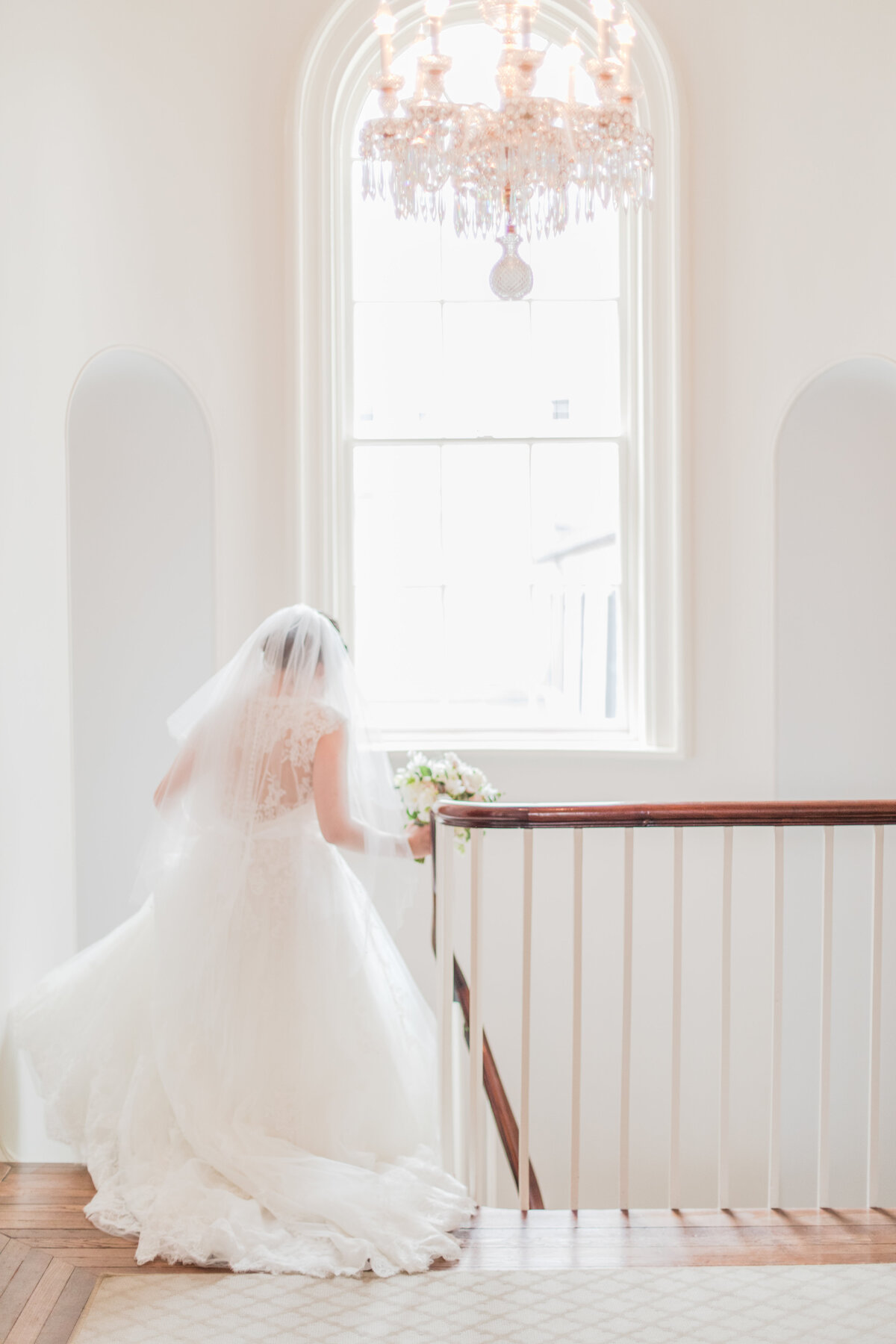 bride walking down the stairs at the decatur house wedding by costola photography