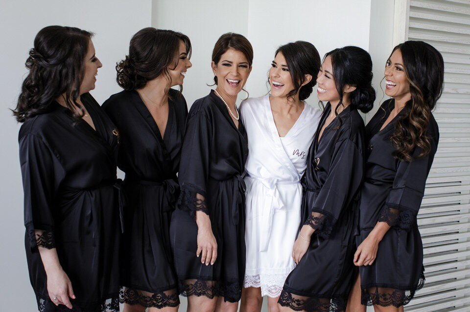Bride and bridesmaids pose in custom robes