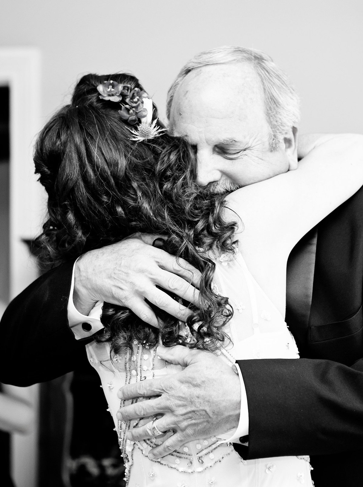Dad hugs his daughter during Dad first look