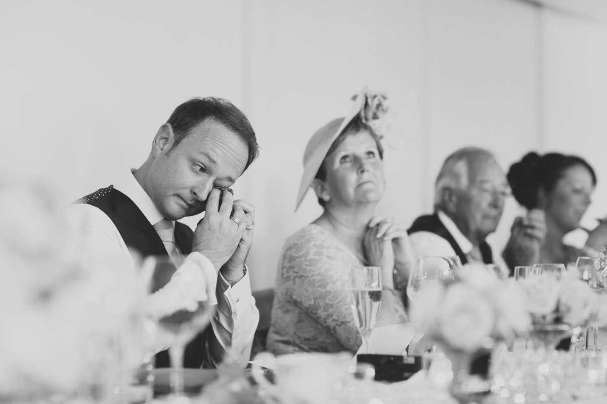 groom crying in speeches at wedding