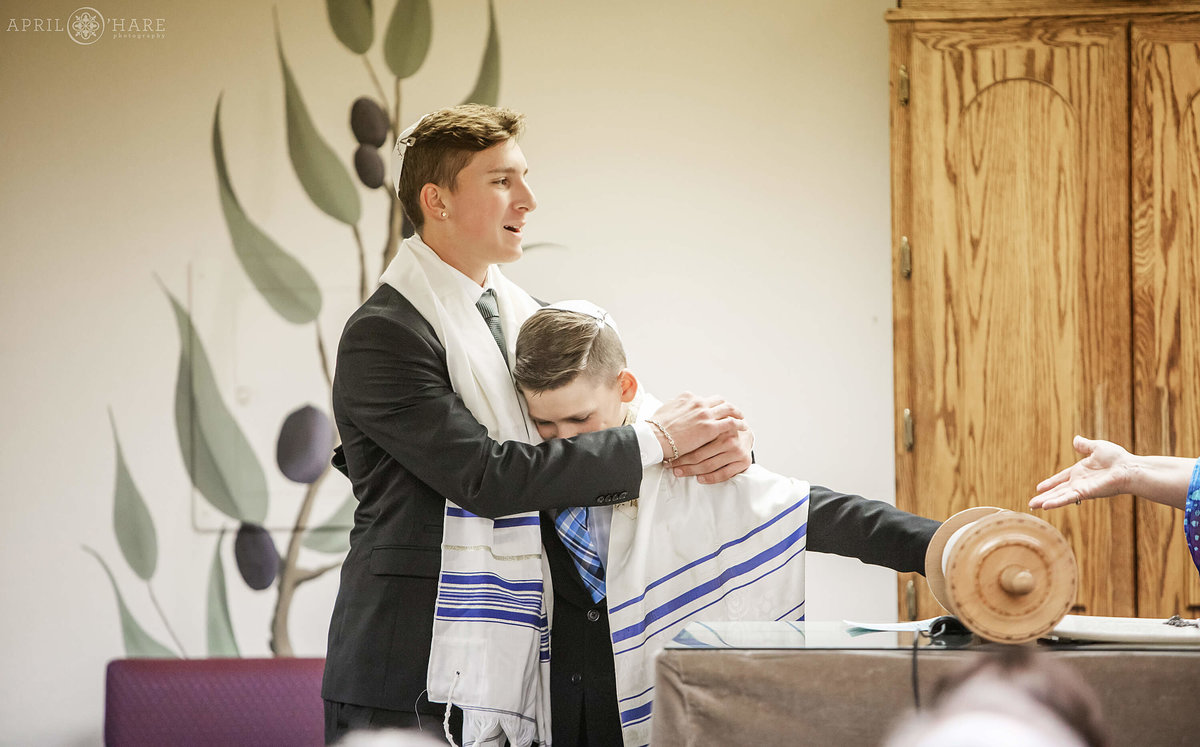 Brothers hug at Bar Mitzvah at B'Nai Chaim in Lakewood Colorado