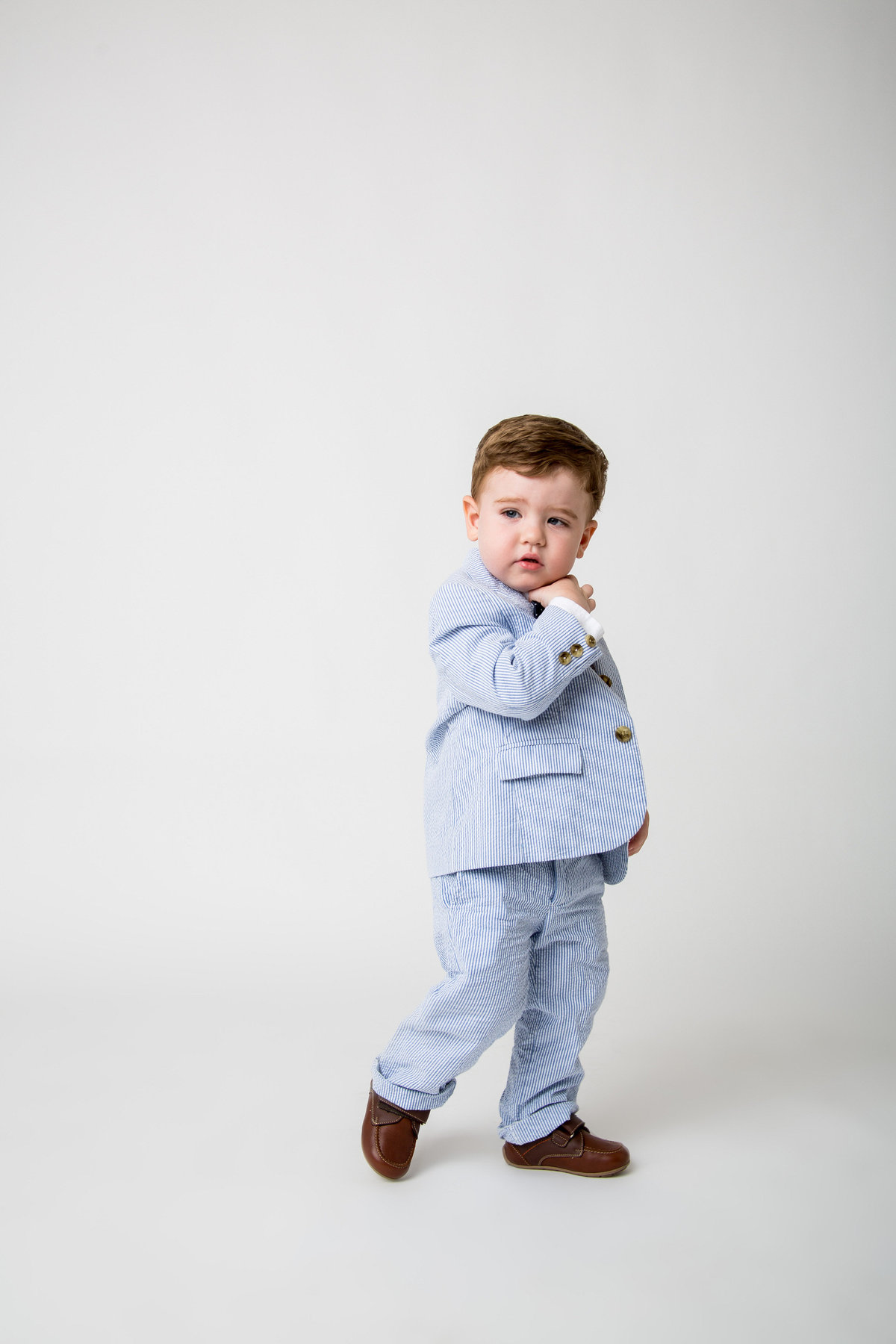 photo of baby toddler wearing blue and white pinstripe suit taken by San Antonio Photographer Expose The Heart Photographer