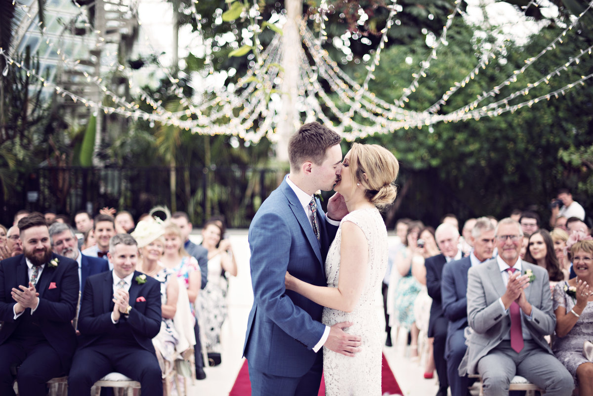 The First Kiss during a ceremony at Sefton Park Palm House