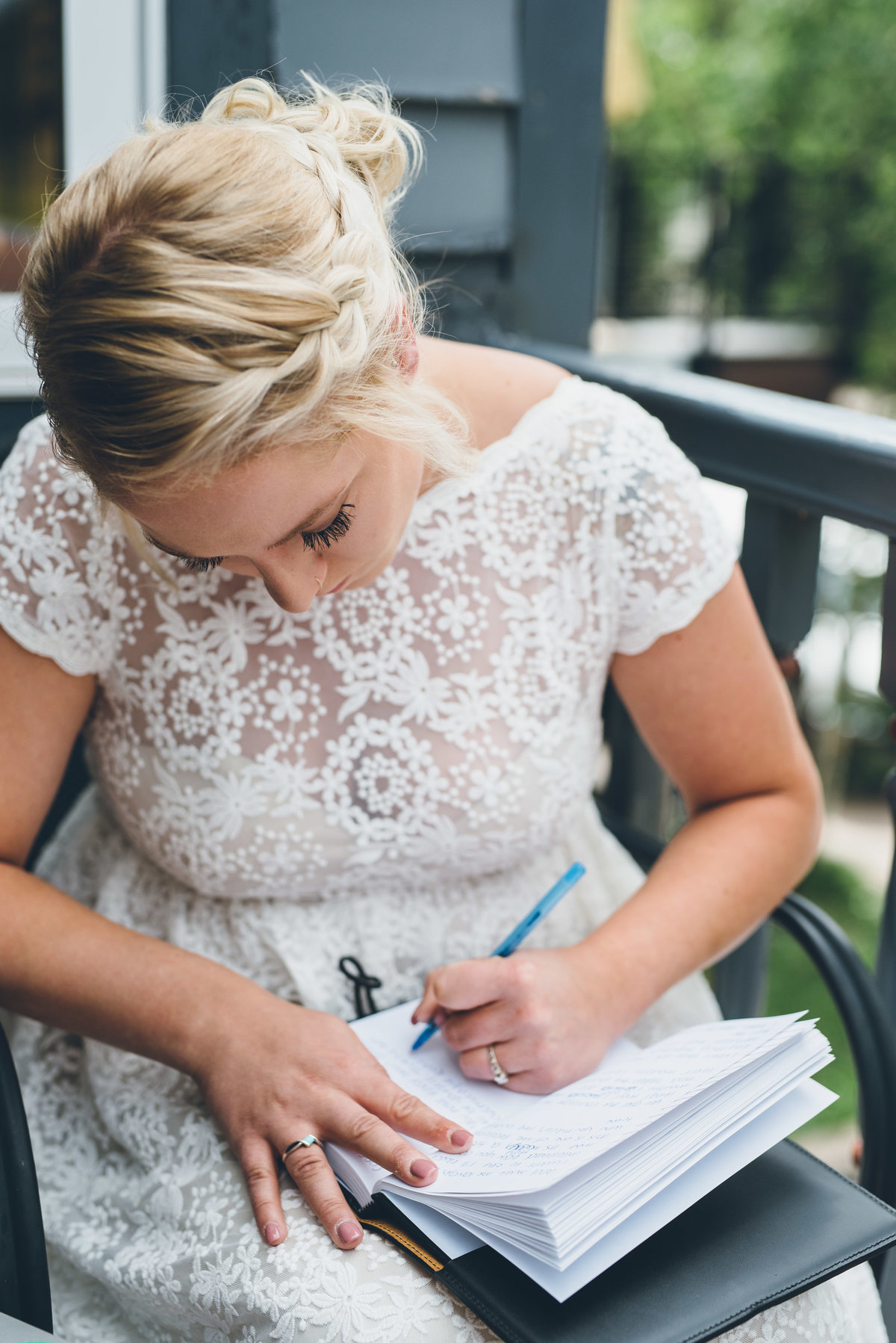 Bride writing her vows on her wedding day
