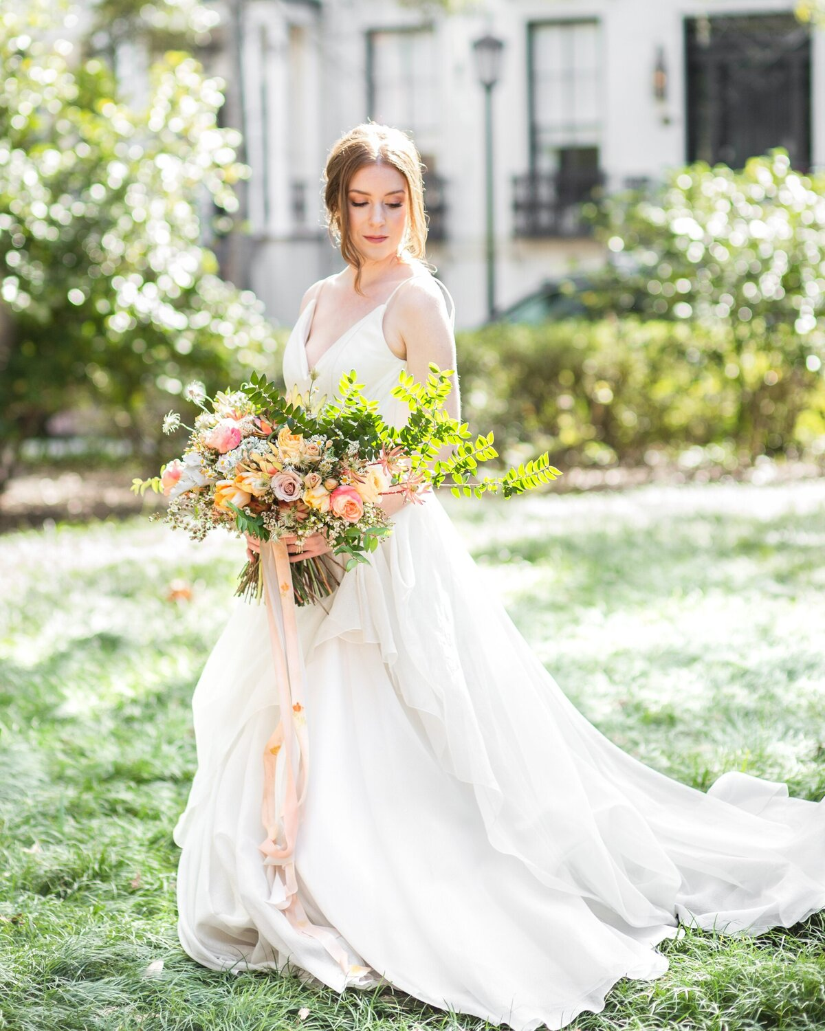 beautiful bride in a square  in savannah