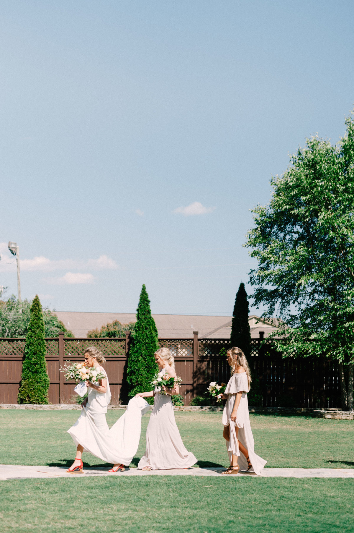 Bridesmaids helping bride in Wedding at Park Crest Hoover Alabama