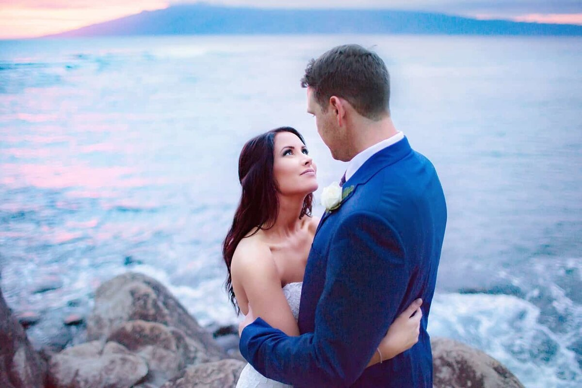 Bride stares into groom's eyes after their wedding at Merriman's in Kapalua, Maui