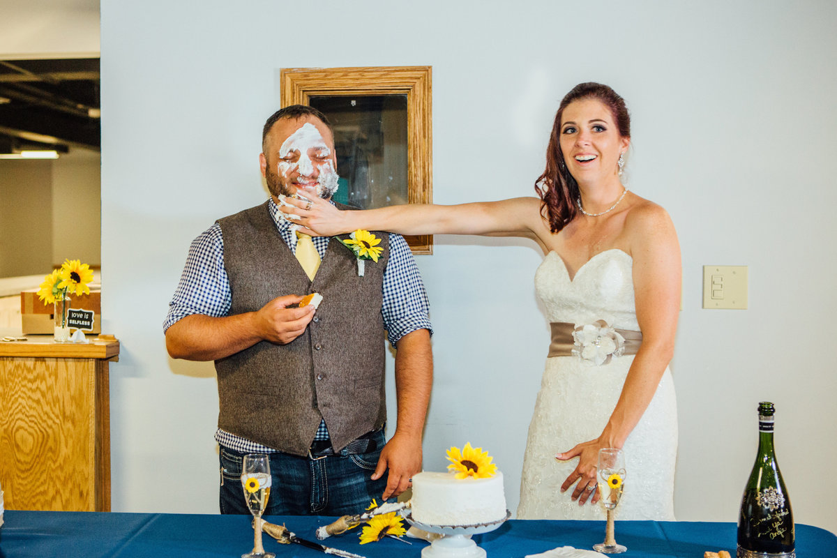 Bride smearing cake on groom