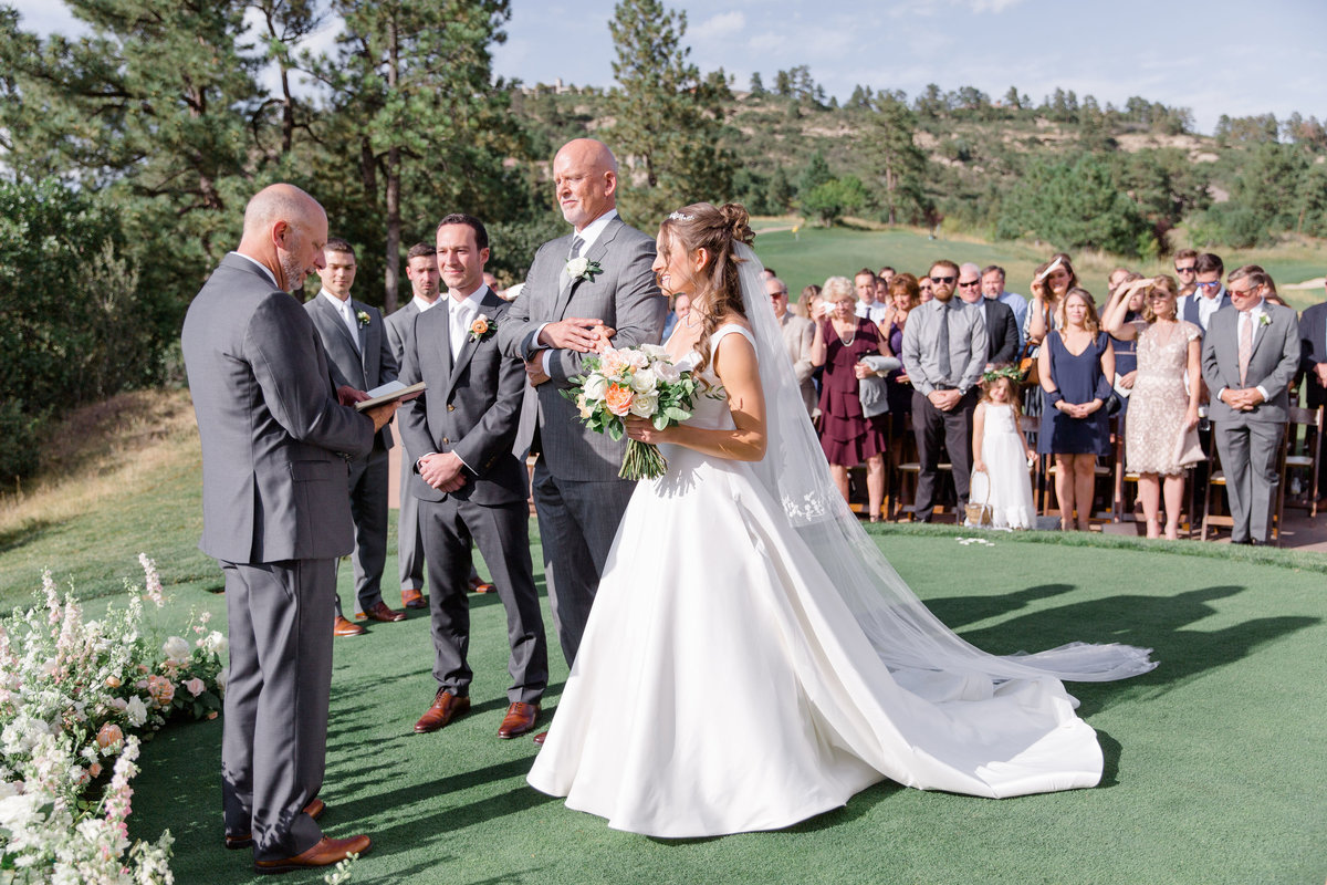 Outdoor wedding ceremony at Castle Pines Golf Club in Colorado
