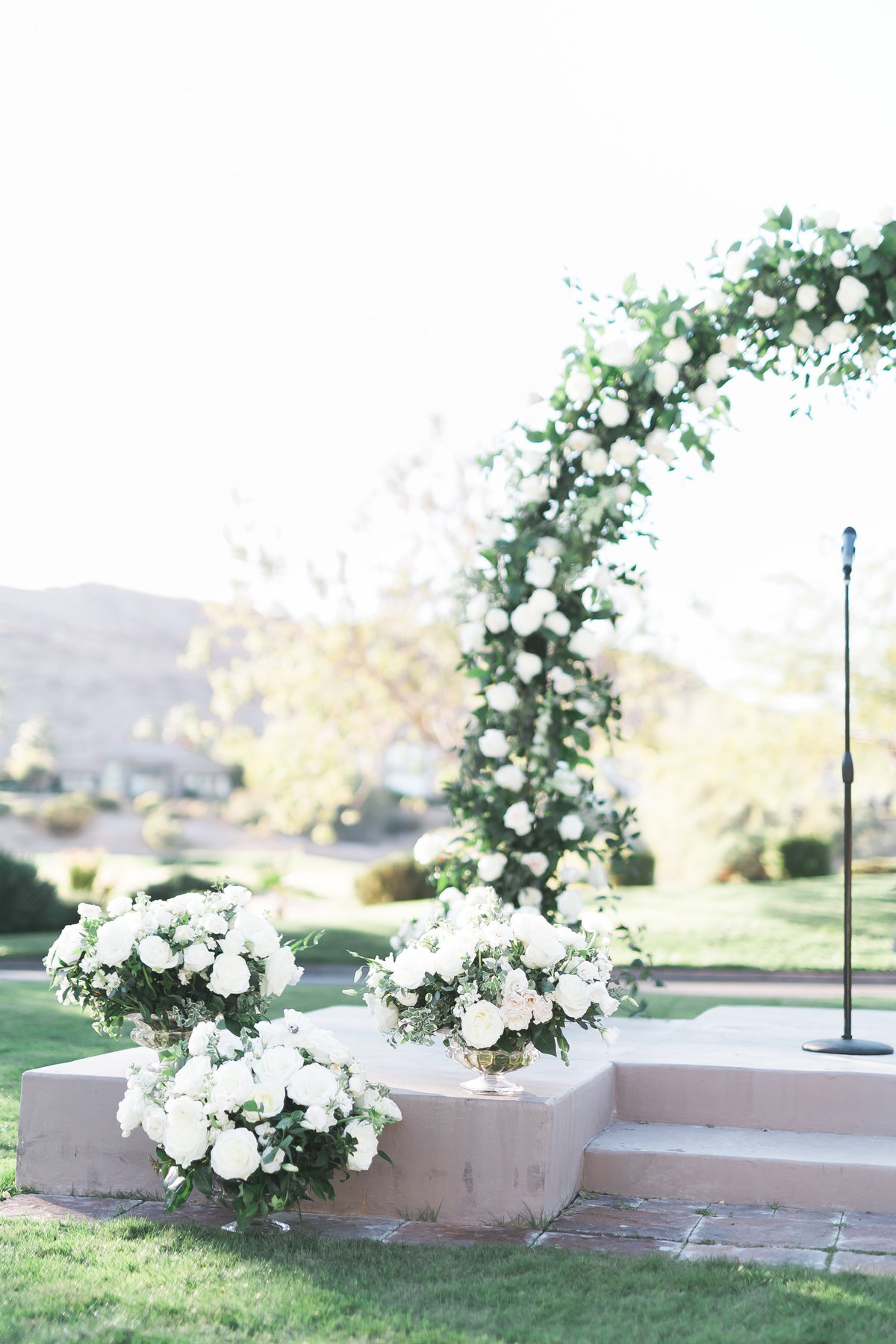 white floral ceremony arch at Red Rock Country Club Las Vegas