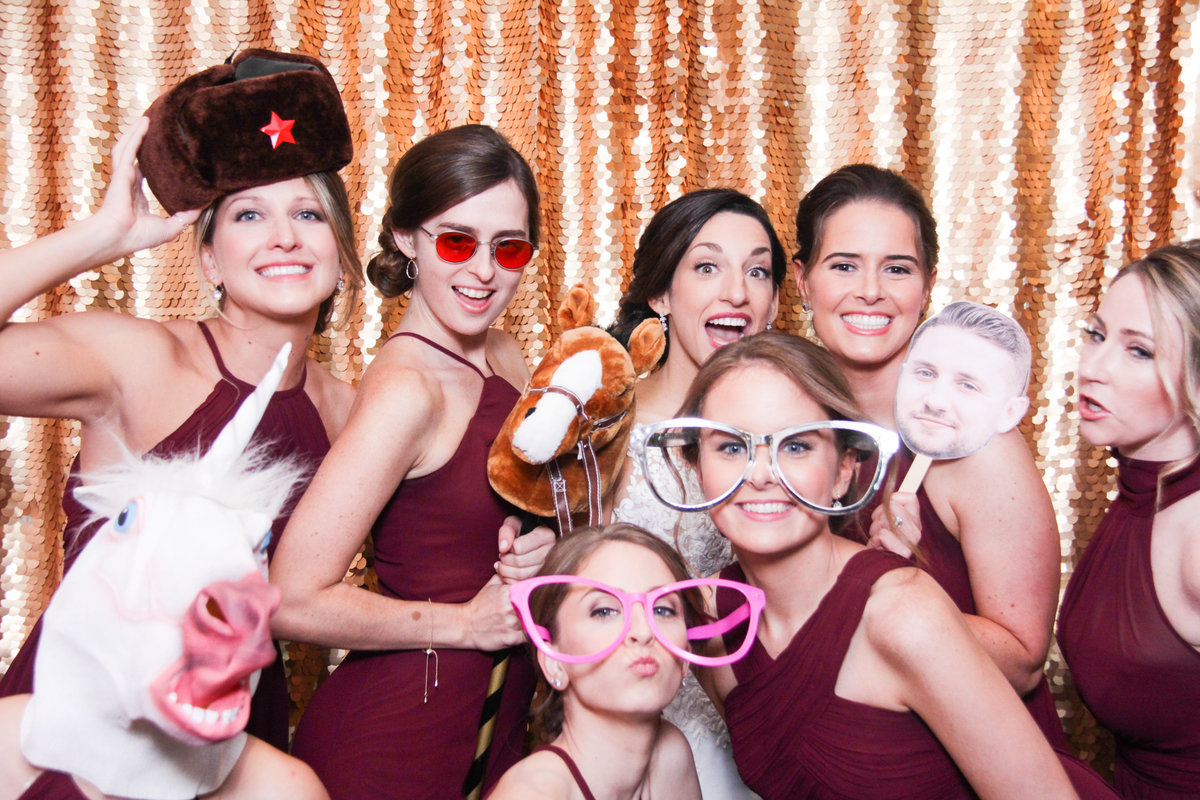 bridemaids having a blast with the photo booth