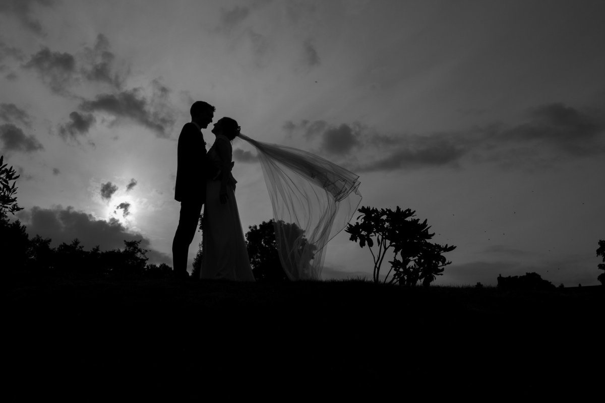 Black and white silhouette of weding couple at Upton Barn in Devon_