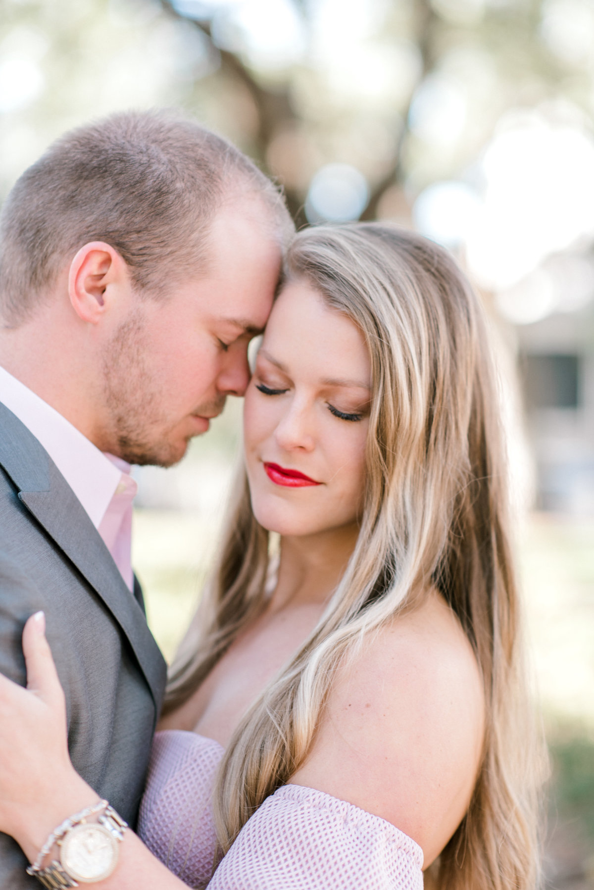 Tender moment between couple during engagement session