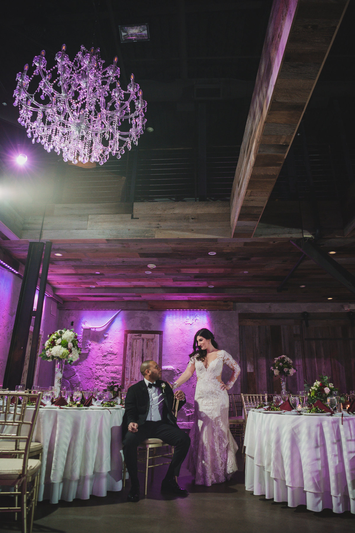 photo of bride and groom posing and looking at each other in wedding reception at The Loft by Bridgeview