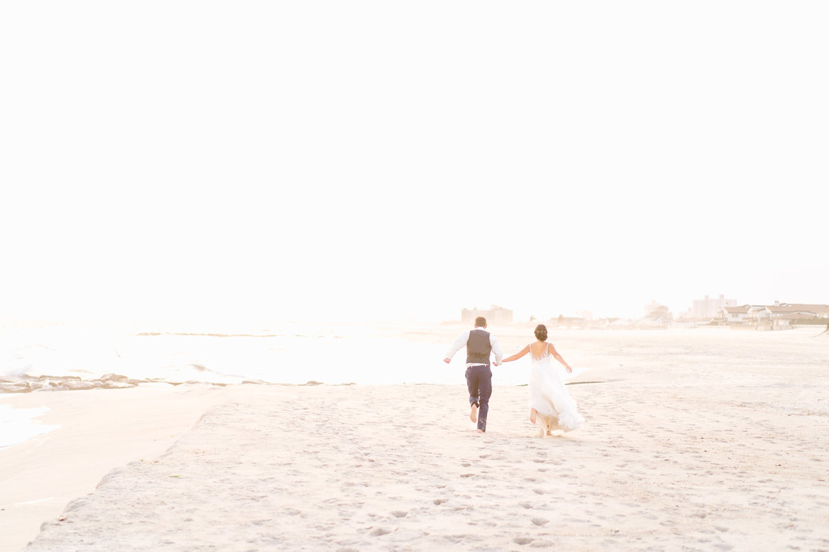 bride-with-groom-on-beach