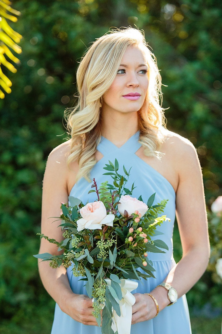blue bridesmaid dress with bouquet