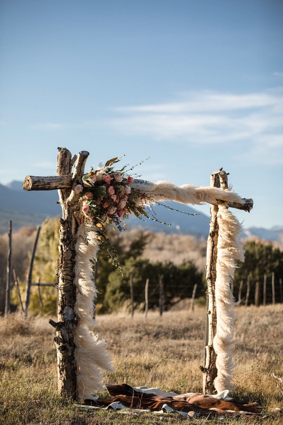 Everett Ranch Rocky Mountain Wedding Outdoor Barn Rustic Salida Colorado Alpaca Collegiate Peaks Vintage Ranch Arbor Dried Florals Wood Posts