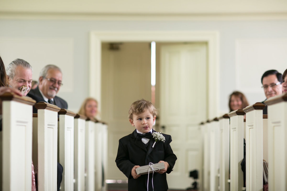 Ring Bearer walking down the isle at Martha-Mary Chapel at greenfield village