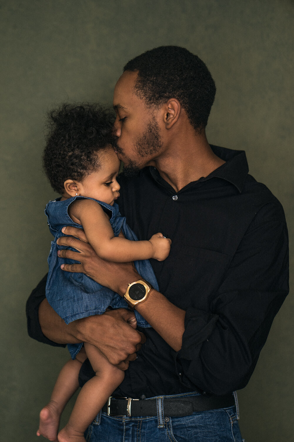 Father and one year old daughter in a candid moment during family photoshoot