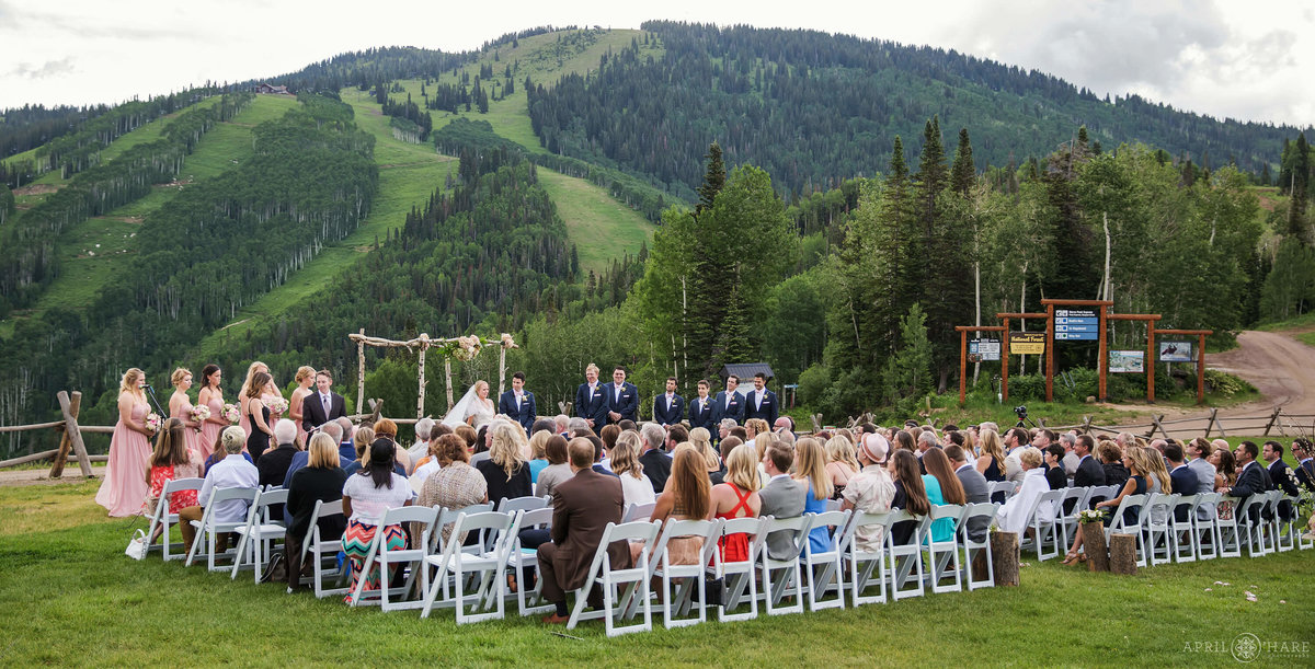 Beautiful Outdoor Wedding on Mt. Werner  with ski slope backdrop during summer in Steamboat Springs Colorado