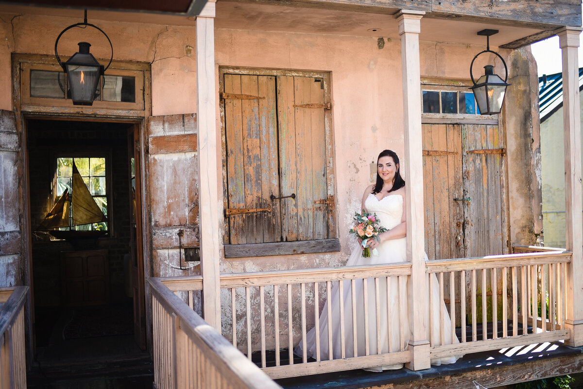Beautiful wedding photography: Bride on the balcony at Race & Religious in New Orleans, NOLA Wedding
