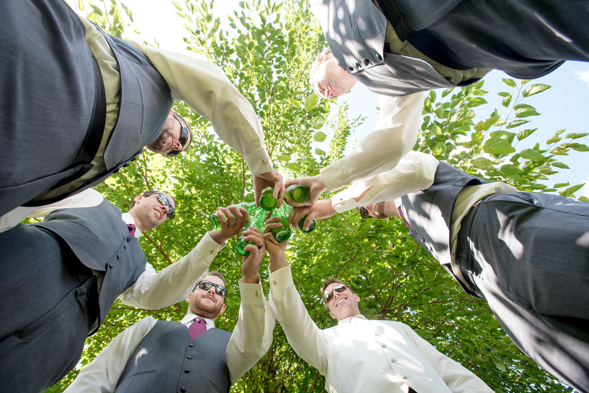 groomsmen cheering outside at Willow Creek Golf and Country Club wedding photo