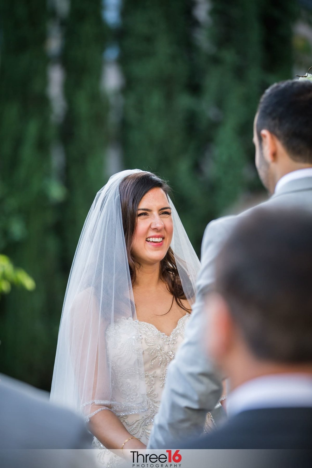 Bride smiles big at her Groom during the ceremony