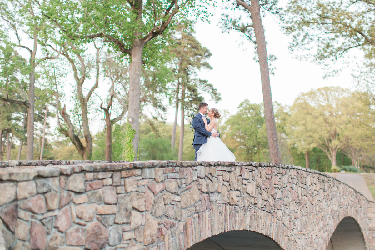 Bride and groom on the bridge at James River Country Club