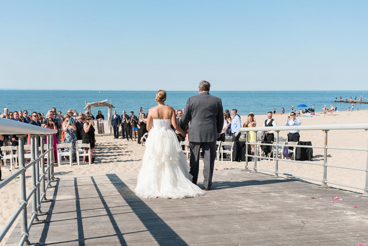 photo of dad walking bride down the aisle for beach ceremony wedding at Pavilion at Sunken Meadow