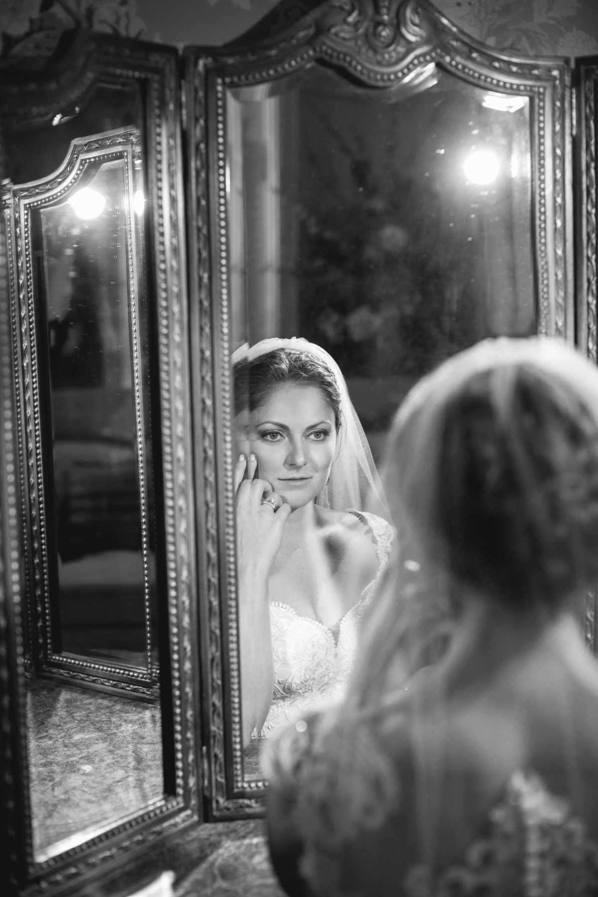 bride looking in mirror at ashford estate wedding