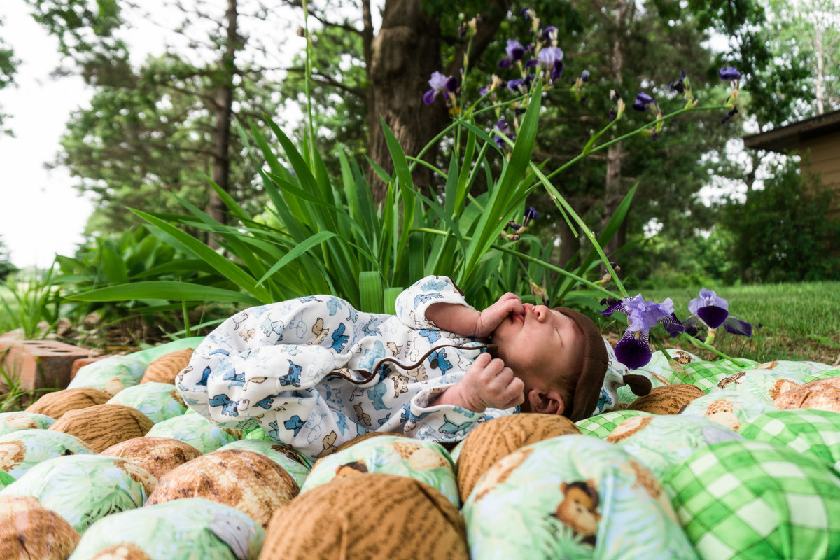 Baby sleeping on blanket in grass