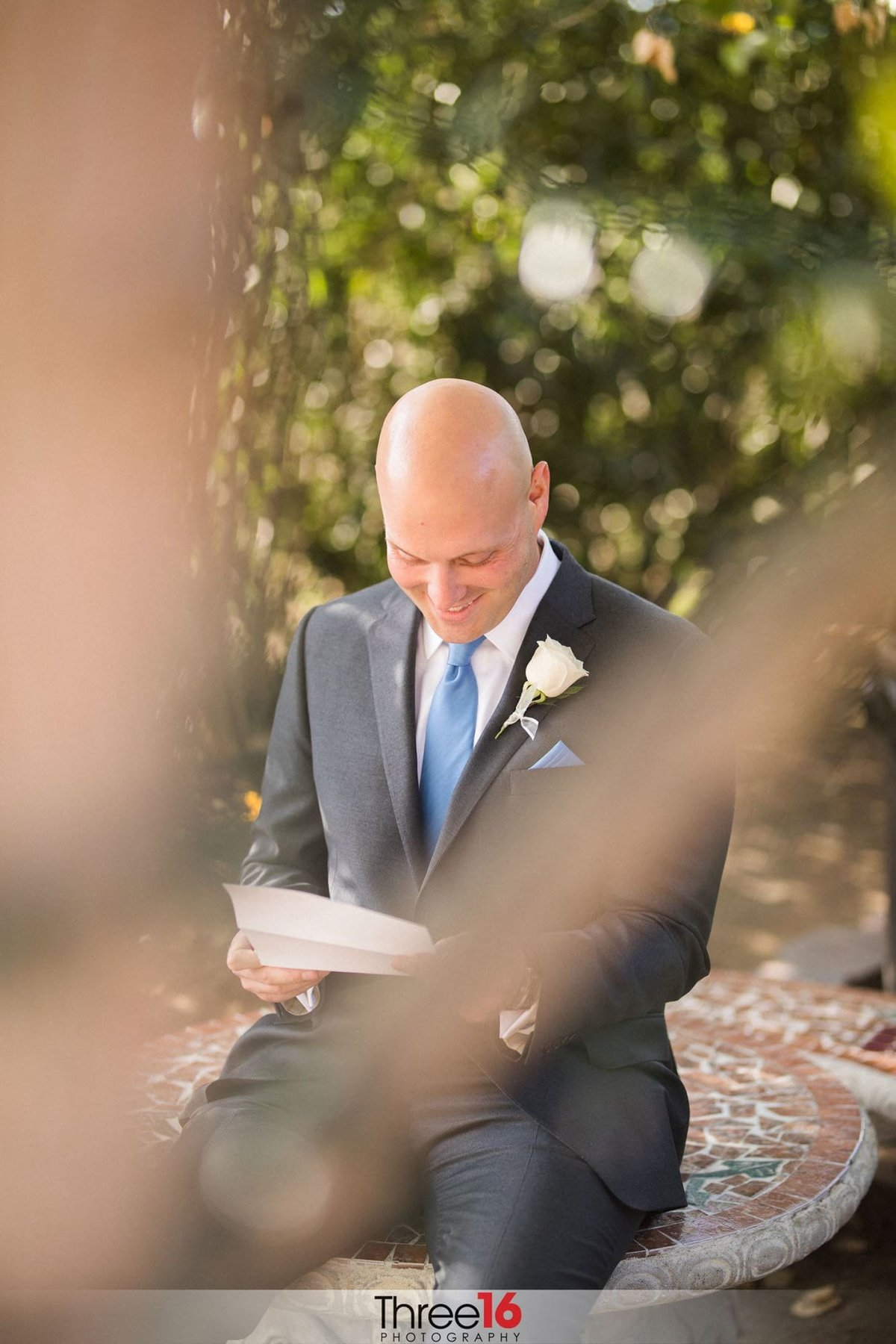 Groom reading a note from his Bride to be