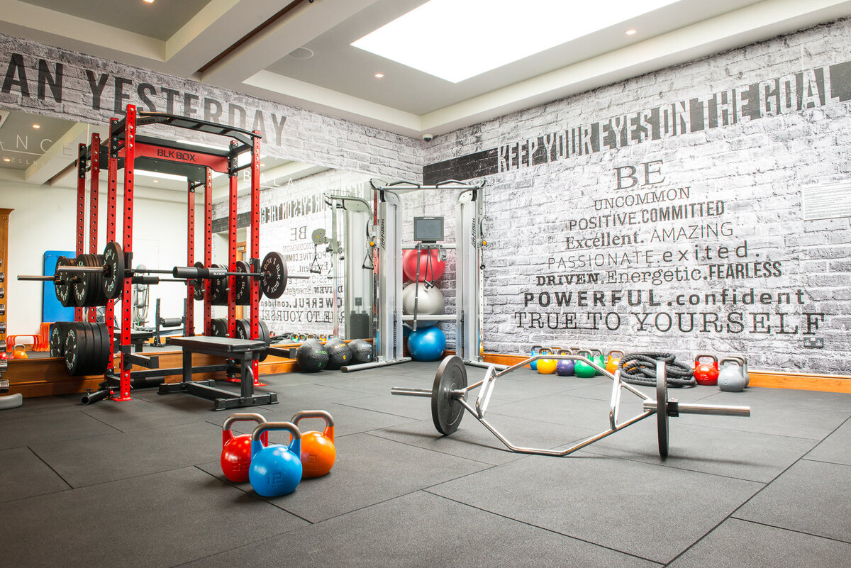 Interior of gym with grafitti walls and colourful kettle bells