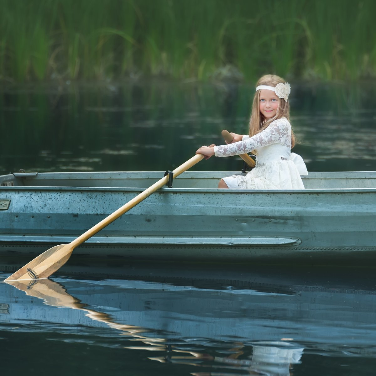 Portrait of Child in Canoe Cle Elum Family Photographer
