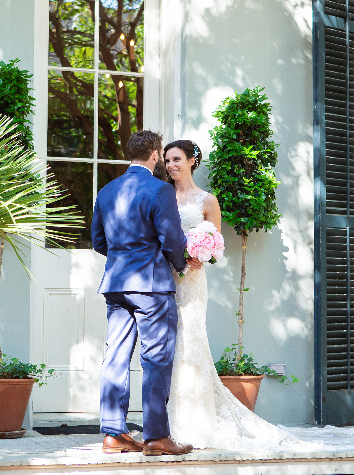 nola bride smiling at groom before destination wedding ceremony at The Terrell House