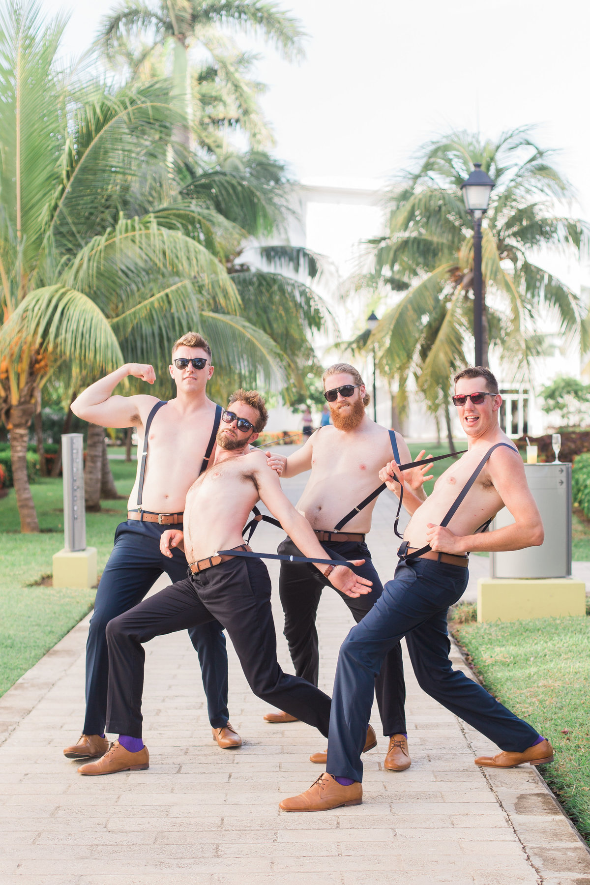 groom and groomsmen with no shirts on