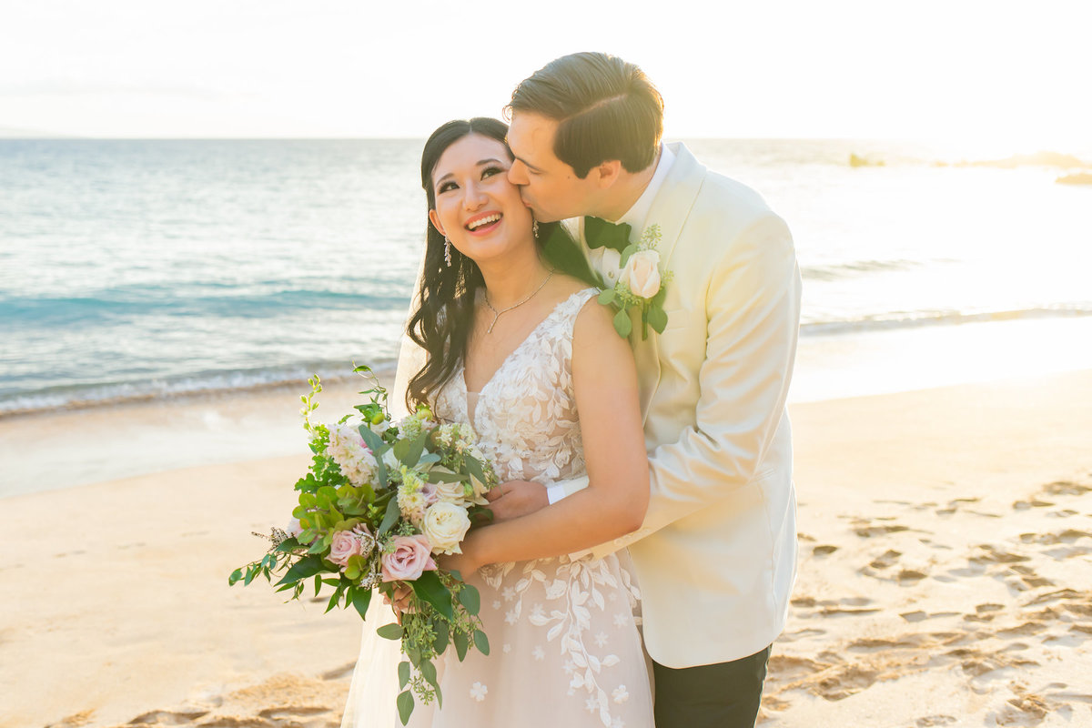 Hawaii wedding photography - bride and groom kissing