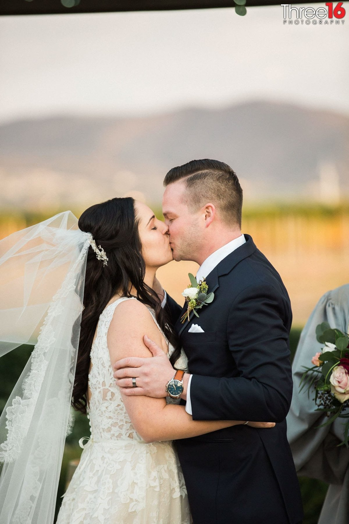 Groom kisses his Bride to seal the deal
