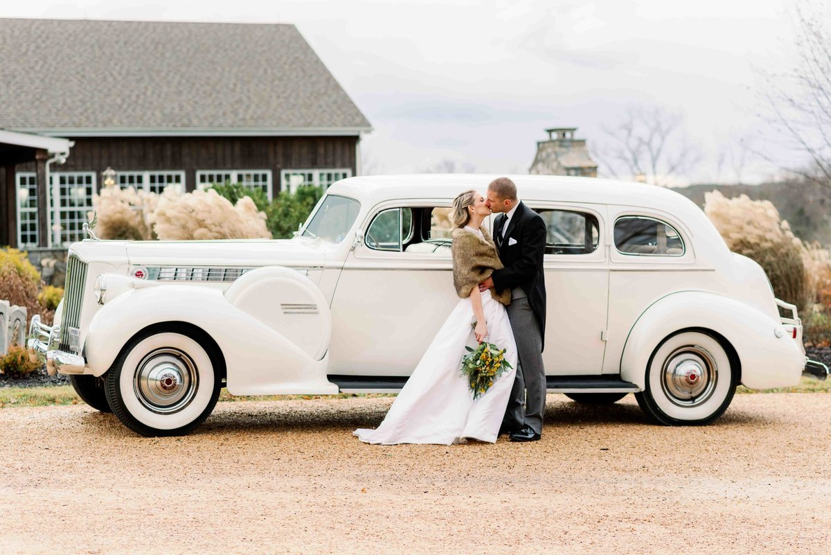 bride and groom kiss in fron of charlottesville virginia venue