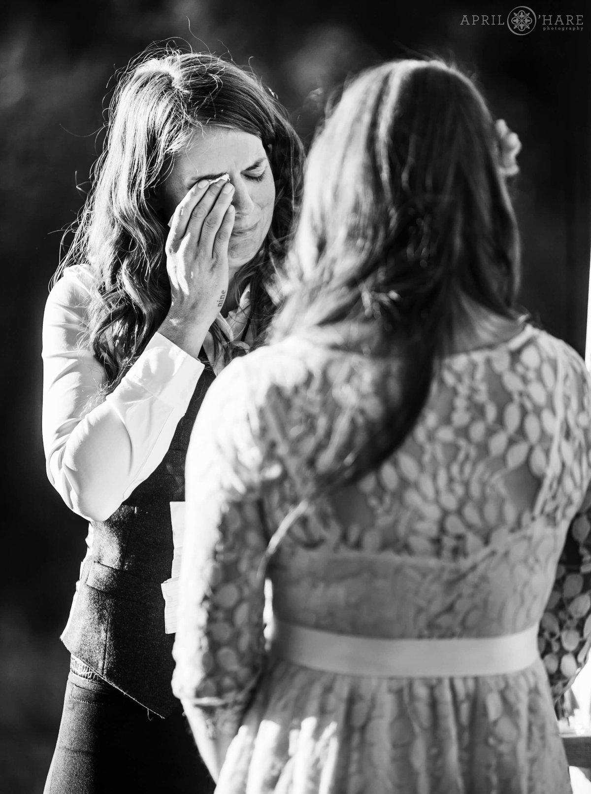 Bride cries during her wedding ceremony in Conifer Colorado