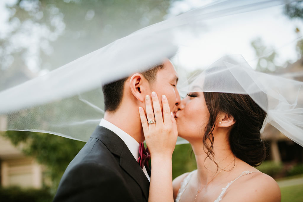 Bride-Groom-Kiss-Under-Veil