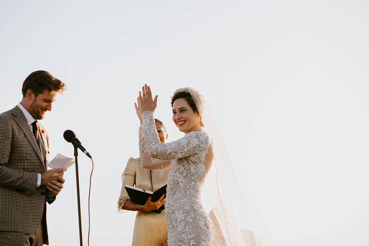 A bride claps at her groom's vows.