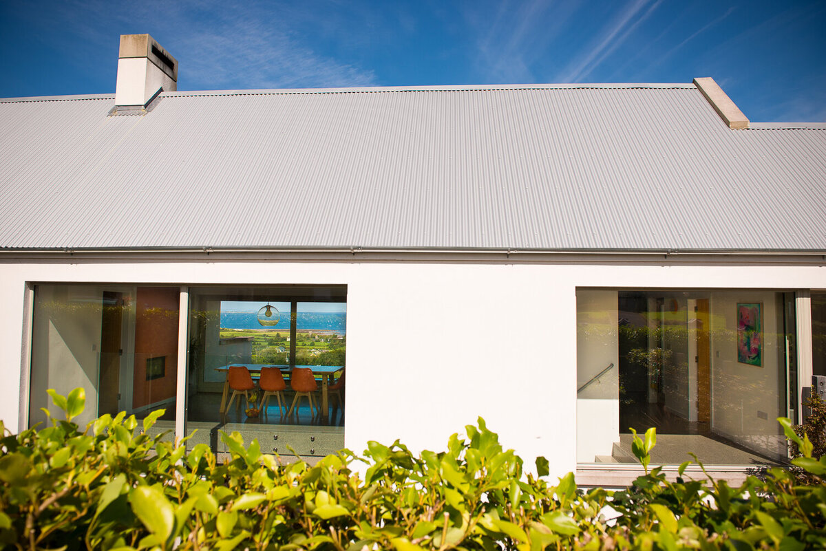Grey galvanised roof on modern house with sea view