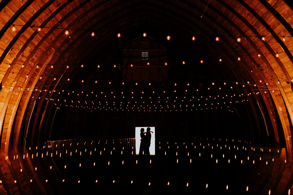 A unique Silhouette of a couple in the barn at Shade Rock Farms