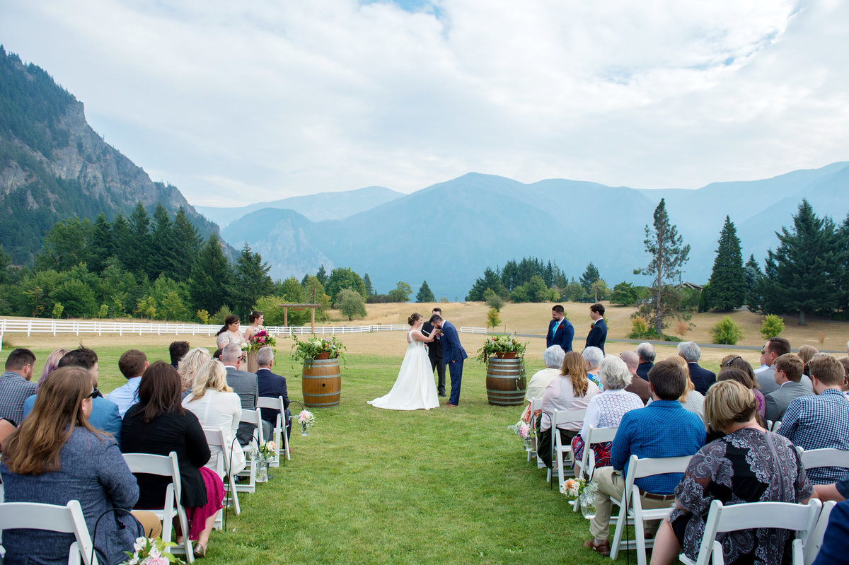 wedding ceremony kiss at wind mountain ranch
