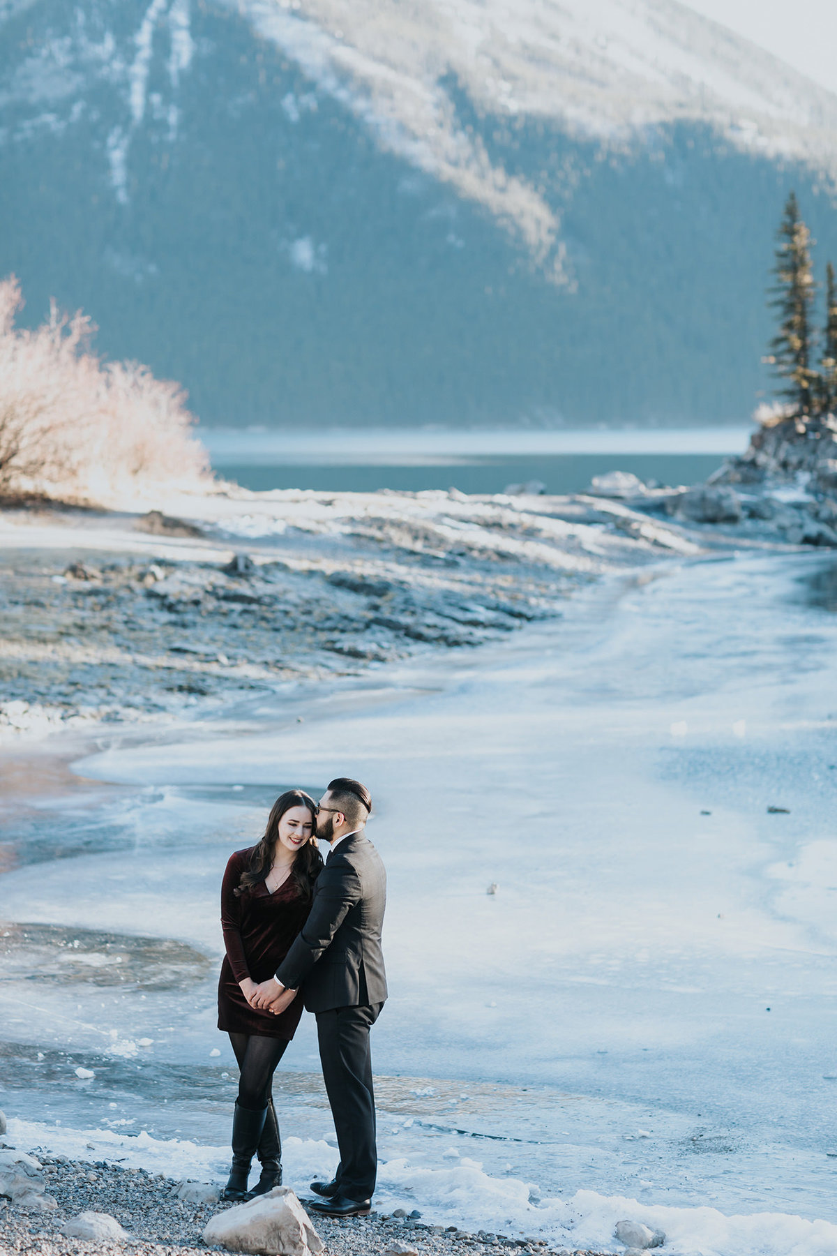 icy blue lake minnewanks winter engagement photography session couples photos