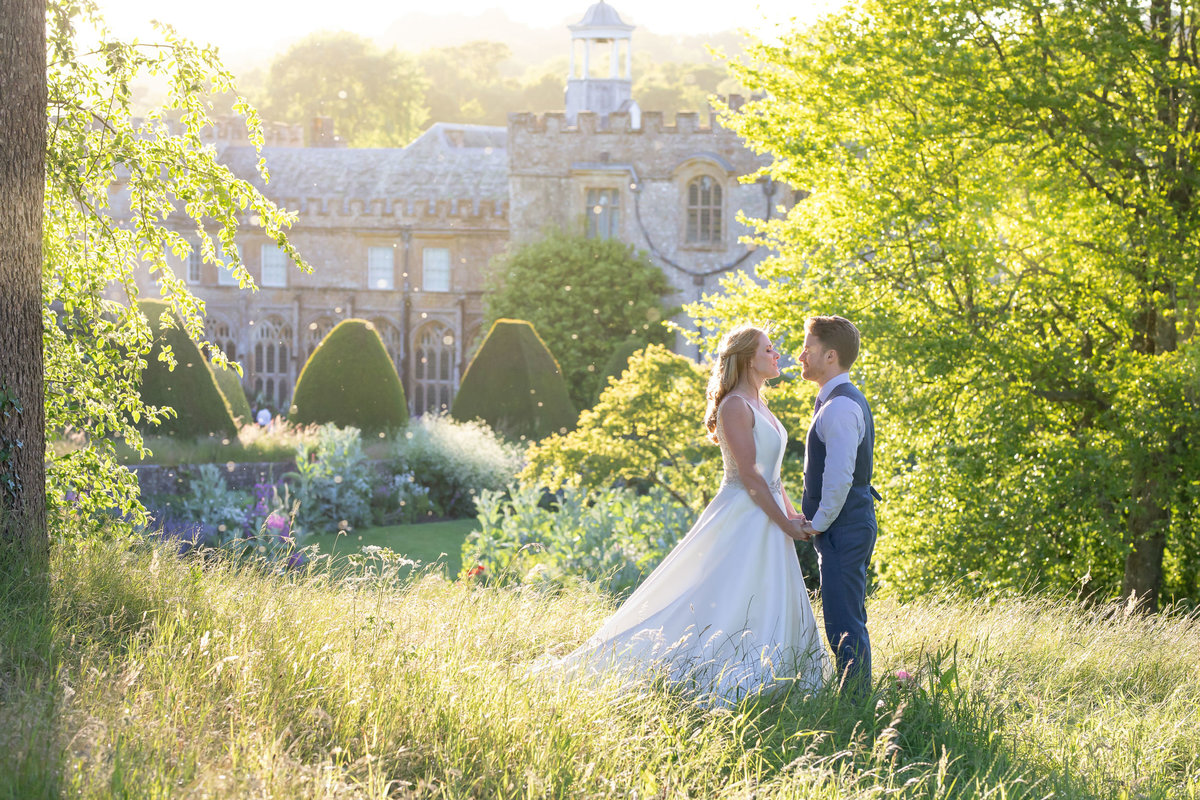 Bride and Groom in Evening light wedding photos at Forde House Wedding in Somerset_