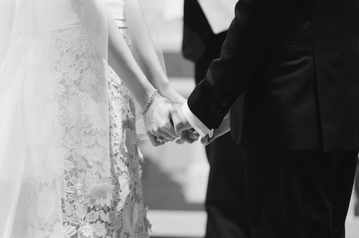 24-KTMerry-weddings-holding-hands-ceremony-black-white