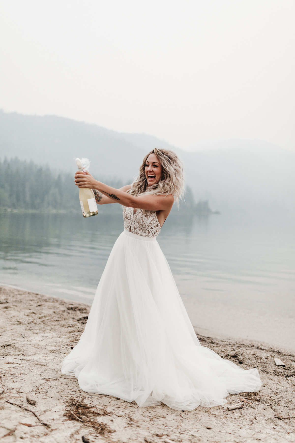 athena-and-camron-sara-truvelle-bridal-wenatchee-elopement-intimate-26-champagne-pop-bride